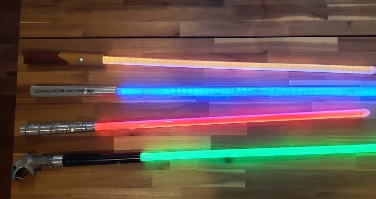 Four lightsabers based on wands from the harry potter series of movies